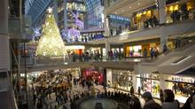 Last minute Christmas shoppers crowd Eaton Centre shopping mall in Toronto, Ont. Dec. 21/2011. (Kevin Van Paassen/The Globe and Mail)