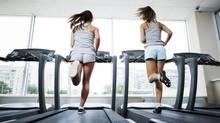 Girls running on treadmills