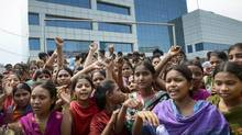 Garment workers rally for better working conditions more than a week after the collapse of Rana Plaza, a garment factory building, on Sunday, May 5, 2013 in Dhaka, Bangladesh. (Ismail Ferdous/AP)