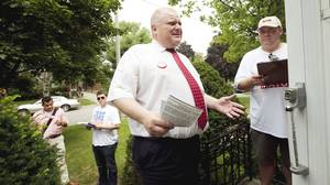 Rob Ford and volunteer Tom Beyer speak with Brian Hill while door-to-door canvassing in Scarborough on July 24, 2010.