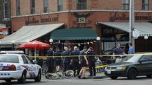 Gunfire rang out in the midst of a crowded outdoor patio at a café on College St. and Montrose Ave. in Little Italy as soccer fans took in a match between Italy and Ireland. (Fred Lum/The Globe and Mail)