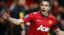 Manchester United's Robin van Persie celebrates his goal against West Ham United during their English Premier League soccer match at Old Trafford in Manchester, northern England, November 28, 2012. (DARREN STAPLES/REUTERS)