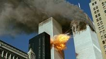 In this Sept. 11, 2001 file photo, United Airlines Flight 175 collides into the south tower of the World Trade Center in New York as smoke billows from the north tower. (Chao Soi Cheong/AP)