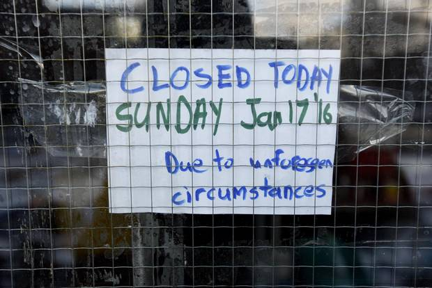 A notice taped to a window informing people of the closure of the Richmond Street Goodwill.