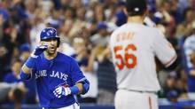 Toronto Blue Jays Jose Bautista gestures towards Baltimore Orioles pitcher Darren O'Day (R) after he hit a two-run home-run off of him during the eighth inning of their MLB American League baseball game in Toronto, June 22, 2013. (MARK BLINCH/REUTERS)