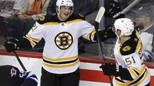 Boston Bruins' Loui Eriksson, left, of Sweden, and Ryan Spooner celebrate Eriksson's game winning goal against the Winnipeg Jets during overtime period NHL pre-season action in Winnipeg on Thursday, September 26, 2013. (JOHN WOODS/THE CANADIAN PRESS)