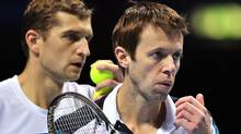 Max Mirnyi of Belarus (L) and his partner Daniel Nestor of Canada (R) talk between points against Bob Bryan of the US and his partner Mike Bryan of the US during their semi-final doubles match on day seven of the ATP World Tour Finals tennis tournament in London on November 26, 2011. Mirnyi and Nestor won the match 7-6 (8-6), 6-4 to book their place in the final. Getty Images / GLYN KIRK (GLYN KIRK/Getty Images)