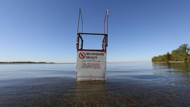 A lifeguard stand sits in high water at Ward's Island Beach where sand used to span out beyond it.