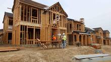 Construction workers build single-family homes in San Diego, March 25, 2013. (MIKE BLAKE/REUTERS)