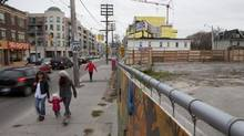 An empty lot at 1884 Queen Street East, at the corner of Woodbine Avenue, is seen in Toronto on Friday. An application for an amendment to a zoning bylaw has been submitted to allow the development of a six-storey mixed-use building. (Matthew Sherwood for The Globe and Mail)