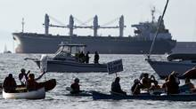 A flotilla of boats and kayakers gather on Burrard Inlet in Vancouver to protest against the use of crude oil tankers on the B.C. coast on Oct. 17, 2010. (DARRYL DYCK/Darryl Dyck for The Globe and Mail)