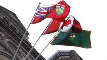 Various photos of the Ontario provincial flag fly over Queen's Park in Toronto, Ontario. (Deborah Baic/The Globe and Mail)