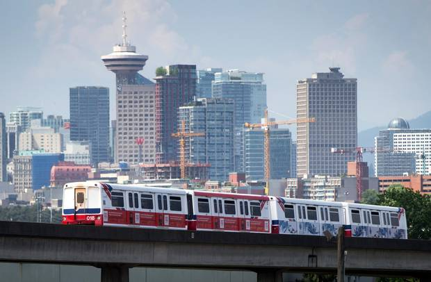 A Skytrain travels past the downtown skyline in Vancouver. The city has one of the best tech-talent pools in Canada.