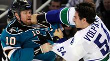Brad Winchester #10 of the San Jose Sharks takes a punch to the mouth from Aaron Volpatti #54 of the Vancouver Canucks during an NHL hockey game at HP Pavilion at San Jose on November 26, 2011 in San Jose, California. The Canucks announced on Saturday that Volpatti will require season-ending shoulder surgery. (Photo by Thearon W. Henderson/Getty Images) (Thearon W. Henderson/Getty Images)