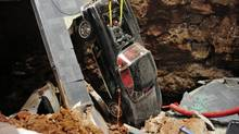 On Feb. 12 eight Chevrolet Corvettes at the National Corvette Museum in Bowling Green, Ky., were swallowed up by a sinkhole. So far five of the cars have been painstakingly extricated. (NATIONAL CORVETTE MUSEUM/NYT)