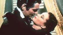 FILE - Clark Gable and Vivien Leigh embrace in this seen from the movie Gone With the Wind. A Utah-based video company and its many new imitators are sanitizing Hollywood movies on video by removing the sex, violence and profanity. That has led to a legal battle involving Hollywood studios and the directors of the films who cry that itês an infringement on their copyright and intellectual property rights. But thereês clearly a huge market out there for family-friendly versions of R-rated films. (CP PICTURE ARCHIVE/ho) (CP)