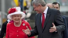 The Queen speaks with Prime Minister Stephen Harper as they arrive for Canada Day celebrations on Parliament Hill on July 1, 2010. (Adrian Wyld/THE CANADIAN PRESS)