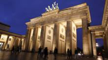 Pedestrians walk past the Brandenburg Gate in Berlin. (Michele Tantussi/Michele Tantussi/Bloomberg News)