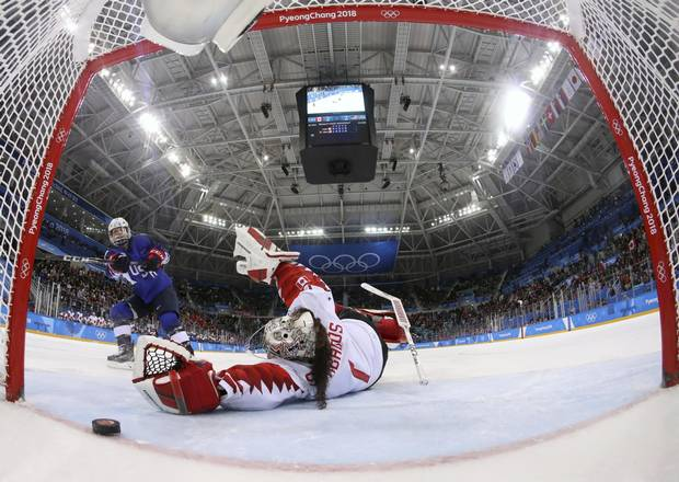 Jocelyne Lamoureux-Davidson of the United States scores in a shootout vs. Canada goaltender Shannon Szabados to win the gold medal for the U.S. on Feb. 22, 2018 in Pyeongchang.