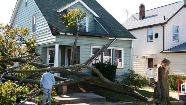 From heat waves and flash floods to backyard celebrations, summer can take a toll on our homes. Do you have the proper insurance? And what are some of the common misconceptions? (Jim Lopes/Getty Images/iStockphoto)