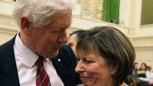 Liberal MP Bob Rae comforts Suzanne Trepanier, widow of Remy Beauregard, the former Rights and Democracy president who died of a heart attack, on Parliament Hill in Ottawa, Tuesday, April 13, 2010. Trepanier testified at committee about the controversy surrounding her late husband. (FRED CHARTRAND/THE CANADIAN PRESS)