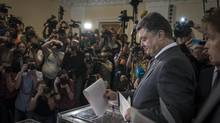 Billionaire Petro Poroshenko casts his ballot in Kiev, Ukraine, May 25. (SERGEY PONOMAREV/NYT)