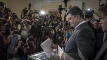Billionaire Petro Poroshenko casts his ballot in Kiev, Ukraine, May 25. (SERGEY PONOMAREV/NYT)