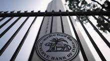 The Reserve Bank of India seal is pictured on a gate outside the RBI headquarters in Mumbai (Danish Siddiqui/Reuters)
