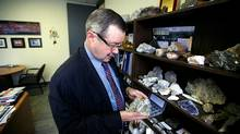 Don Bubar, P.Geo., President and Chief Executive Officer of Avalon Rare Metals Inc., looking over a collection of rare metal samples in the company offices in Toronto, Ontario, Canada during a photo shoot. (Deborah Baic/Deborah Baic/THE GLOBE AND MAIL)