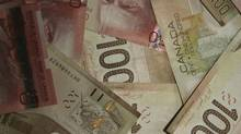 The Canadian dollar erased losses in morning trading, touching 1.008 (U.S.), after the currency hit a 10-week low earlier in the session. (Dan Dragonetti/iStockphoto)