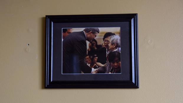 A photo of Foon Hay Lum with former Prime Minister Stephen Harper hangs in her room in her retirement home in Toronto on January 13, 2017.