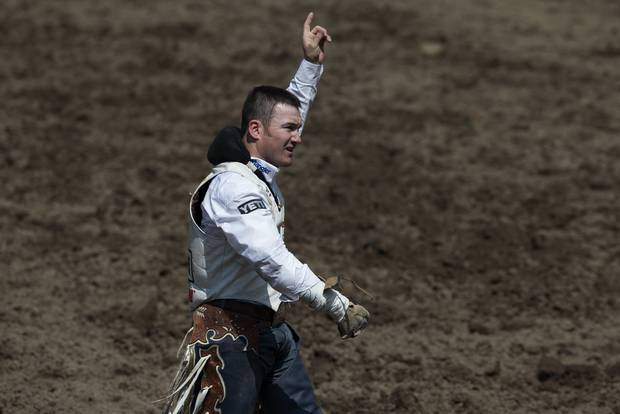 Peebles reacts to his score at the Calgary Stampede rodeo.