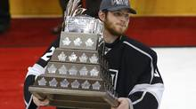 Los Angeles Kings goalie Jonathan Quick holds the Conn Smythe Trophy after being named MVP after his team defeated the New Jersey Devils in Game 6 of the NHL Stanley Cup hockey final in Los Angeles, June 11, 2012. (Danny Moloshok/REUTERS)