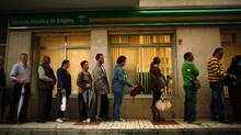 People wait in line to enter a government job centre in Malaga, southern Spain in this April 29, 2011 file photo. Europe's relative lack of labour mobility can be pinned on cultural obstacles, as well as increasingly choosy employers and stiff competition from established migrants. (Jon Nazca/Reuters)