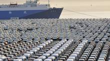 Chinese cars wait to be exported at a port in Dalian, Liaoning province, in this file picture taken October 15, 2012. Auto makers in China are bracing for another year of tepid single-digit growth in 2013. (CHINA DAILY/REUTERS)