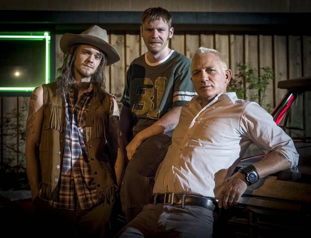 From left, Jack Quaid as Fish Bang, Brian Gleeson as Sam Bang and Daniel Craig as Joe Bang in Logan Lucky.