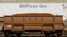 An iron ore train car enters BHP Billiton's loading facility in Port Hedland, Australia. Iron ore made up half of BHP's earnings, with underlying profit from the core ingredient in steel rising 36 per cent to $7.9-billion. (TIM WIMBORNE/REUTERS/TIM WIMBORNE/REUTERS)