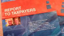 The Alberta government is spending $350,000 to mail out an eight-page, full-colour brochure, shown in Edmonton, Tuesday, May 7, 2013, highlighting the 2013-14 budget. Critics say it's a poor use of public money given the budget is reducing or cutting services across the board while running up $6.3 million in red ink. (THE CANADIAN PRESS)