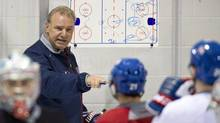 Montreal Canadiens coach Michel Therrien gives out instructions during their first day of training camp in Brossard, Que., on Sunday, January 13, 2013. (Paul Chiasson/THE CANADIAN PRESS)