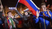 Pro-Russian people celebrate in the central square in Sevastopol, Ukraine, late Sunday, March 16, 2014. (Andrew Lubimov/AP Photo)