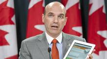 Opposition House Leader Nathan Cullen shows off an NDP website seeking public comments on the Conservative budget at an Ottawa news conference on May 15, 2012. (Adrian Wyld/Adrian Wyld/The Canadian Press)