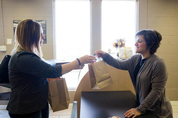 Owner Carla Roppo-Owczarek, right, serves a customer at Canova.