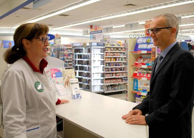 David Gardner with pharmacist Tena Taylor, owner of a Shoppers Drug Mart.