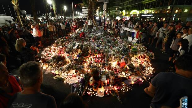 People paid tribute to those killed in Nice, France on the Promenade des Anglais in July, 2016. A French-Tunisian attacker killed 84 people as he drove a lorry through crowds who had gathered to watch a firework display during Bastille Day Celebrations. The attacker then opened fire on people in the crowd before being shot dead by police.