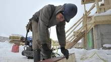 A construction worker on a new home job site in Brampton, Ont., in January, 2014. (J.P. Moczulski for The Globe and Mail)