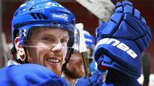 Daniel Sedin of the Vancouver Canucks looks on from the bench during their first post-season practice at Rogers Arena in Vancouver, Canada April 9, 2012. The Canucks will play the L.A. Kings in Game 1 of the Stanley Cup Quarterfinals April 11, 2012. (Jeff Vinnick/The Globe and Mail) (Jeff Vinnick/The Globe and Mail)