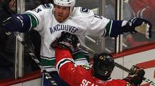 Brent Seabrook #7 of the Chicago Blackhawks hits Raffi Torres #13 of the Vancouver Canucks in the chest with his stick after Torres took him down in the 2nd period in Game Three of the Western Conference Quarterfinals during the 2011 NHL Stanley Cup Playoffs at the United Center on April 17, 2011 in Chicago, Illinois. (Photo by Jonathan Daniel/Getty Images) (Jonathan Daniel//Getty Images)