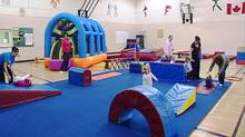 Children under supervision move through an obstacles course in a Go-Go Gymnastics Tumble Tots class. (DCAM PRODUCTIONS/COURTESY OF GO-GO GYMNASTICS)