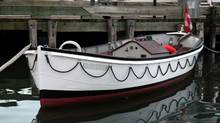 Small White Boat (Daniel Dupuis/Getty Images/iStockphoto)
