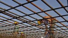 A worker welds iron rods at the construction site of a commercial complex in the western Indian city of Ahmedabad November 29, 2012. In India, the economy expanded at its slowest pace in three years in the third quarter. Gross domestic product was up 5.3 per cent from the year-ago period – a respectable figure if it were in western countries, but a sharp deceleration from figures that in recent years have frequently exceeded 9 per cent. (AMIT DAVE/REUTERS)